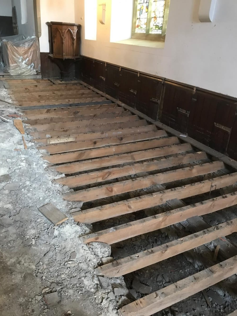 Pews removed exposing floor joists