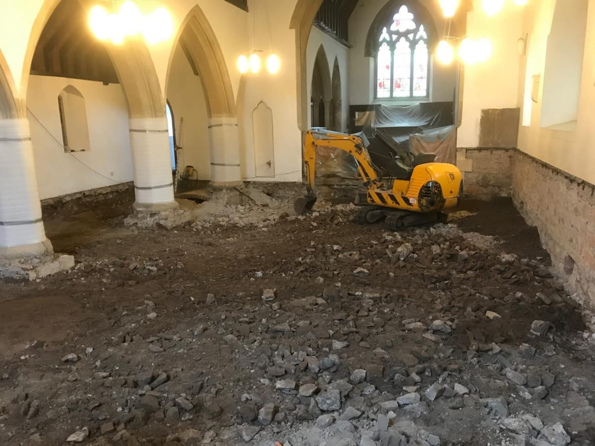 Mini-digger inside church
